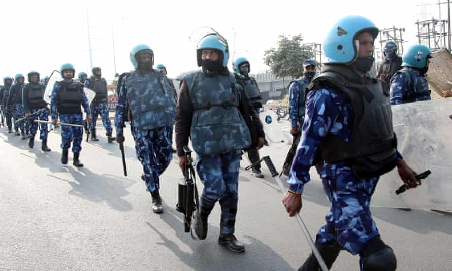 Indian riot police head towards farmers' protest camp at the Delhi-Ghazipur border.