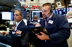 Traders work on the floor of the New York Stock Exchange (NYSE) in New York.