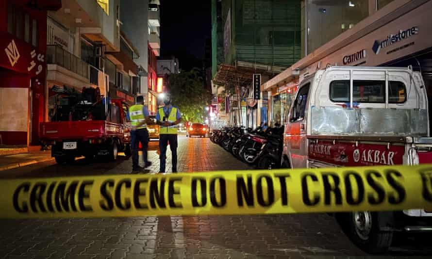 Maldivian police officers secure the area after the explosion in Malé, Maldives.