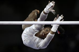 Simone Biles of the US performs on the uneven bars at the gymnastics world championships in Stuttgart.