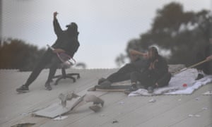 Detainees are seen on the roof during a riot at the Frank Baxter juvenile justice centre on the NSW central coast.