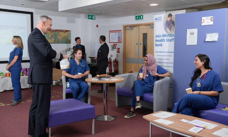 David Fielding with NHS staff at Whittington hospital