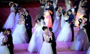 Fifty-six couples participate in a group wedding ceremony