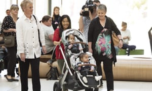Nima and Dawa, with their mother Bhumchu Zangmo, leave the Royal Childrens Hospital in Melbourne on Monday