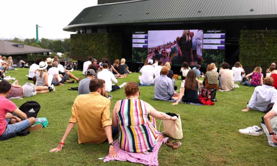 Spectators on Henman Hill watch the action on day four at Wimbledon