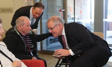 Prime minister Scott Morrison (right) and health minister Greg Hunt (above) during a visit to the Goodwin aged care services facility in Canberra.
