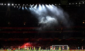 Smoke from the flares let off by the Cologne fans, swirls around the Emirates.