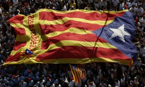 People carry a giant 'estelada' flag