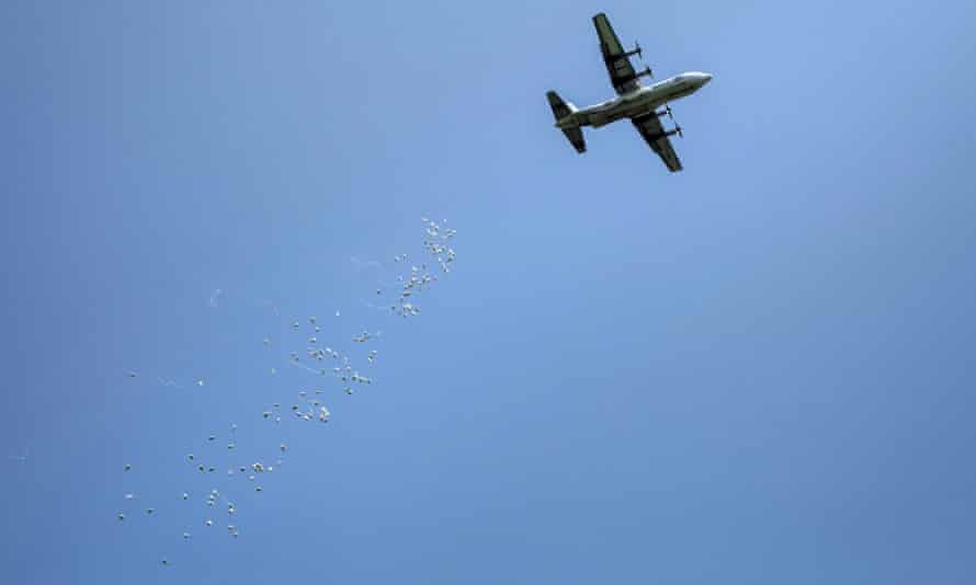 An International Red Cross plane drops emergency food supplies over South Sudan in 2014.