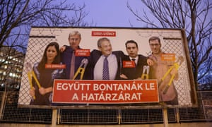 A Fidesz election poster in Budapest shows George Soros and opposition politicians with bolt cutters at a border fence.