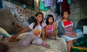 Brigette Sicat, 10, above left, with her cousin Arianne, 11, and her grandmother Juana.