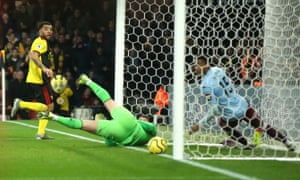 Troy Deeney watches his opener trickle over the line.