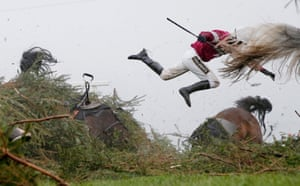 Nina Carberry flies off Sir Des Champs as they fall at The Chair fence during the 2016 Grand National at Aintree Racecourse.