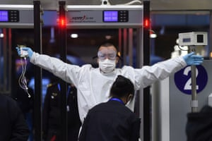 A traveller passes through a security check at Wuchang railway station in Wuhan