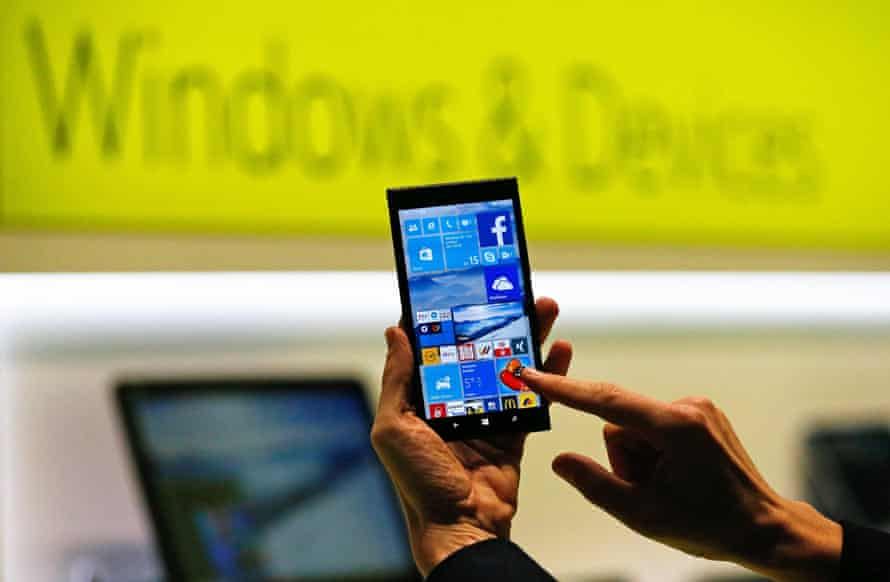 Microsoft showing a smartphone with the Windows 10 operating system at the CeBIT trade fair in Hanover in March