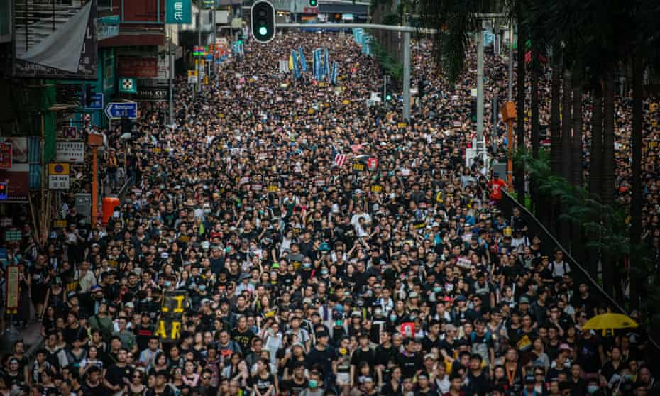Demonstrators march in Hong Kong on Sunday.
