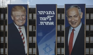 A posters featuring Benjamin Netanyahu and Donald Trump hangs from a Jerusalem building.