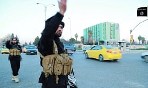 Isis released a propaganda video showing two deaf-mute brothers directing traffic in Mosul