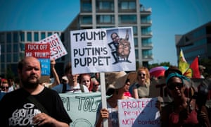 """FINLAND-RUSSIA-US-POLITICS-DIPLOMACY-SUMMIT-DEMOProtesters take part in the so-called """"Helsinki against Trump and Putin"""" demonstration on the sidelines of the meeting between US President Donald Trump and Russian counterpart Vladimir Putin on July 16, 2018, in Helsinki, Finland. / AFP PHOTO / Jonathan NACKSTRANDJONATHAN NACKSTRAND/AFP/Getty Images"""