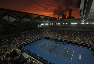 The sun sets over the Melbourne skyline as Croatia's Marin Cilic and Spain's Fernando Verdasco play their third round match at the Australian Open tennis championships.