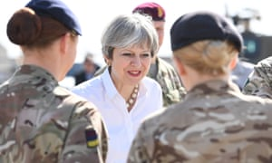 Theresa May speaks with British soldiers at the Camp Taji military base in Iraq.