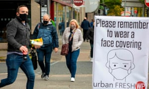 Pedestrians wear face masks in Belfast in October.