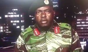 A member of Zimbabwe's military delivers a statement after troops took control of the state broadcaster