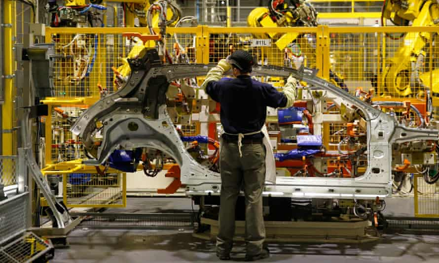 An employee on the production line at the Nissan plant in Sunderland,