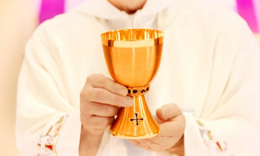 A Northern Ireland Catholic diocese has introduced sanitary measures around communion and a ban on shaking hands as a 'sign of peace' due to fears of a flu outbreak.
