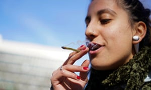 Luisina Mezquita smokes a joint of legal marijuana she bought at a pharmacy in Montevideo, Uruguay.