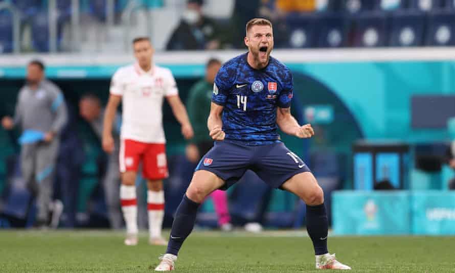 Slovakia's Milan Skriniar celebrates at the final whistle in St Petersburg.