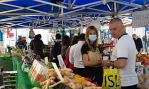 Shoppers at a fruit and vegetable market in Staines-upon-Thames in late June.