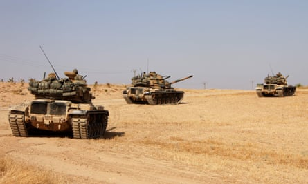 Turkish soldiers drive American-made M60 tanks in the town of Tukhar, north of Syria's northern city of Manbij.
