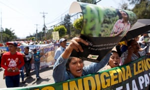 An indigenous woman holds a poster with a photograph of slain environmental rights activist Berta Caceres during a march to demand justice in Tegucigalpa.