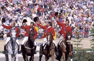 Australia's show jumping team parade around the International Equestrian Centre after winning gold in three-day eventing.