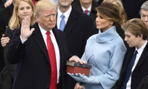 Melania Trump stands beside Donald Trump as he takes the oath of office.