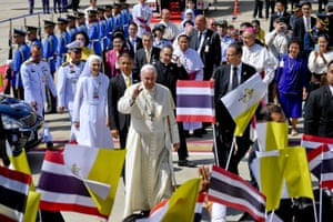 Francis walks with his cousin Ana Rosa Sivori (centre left) as he arrives at the Military Air Terminal of Don Muang Airport in Bangkok