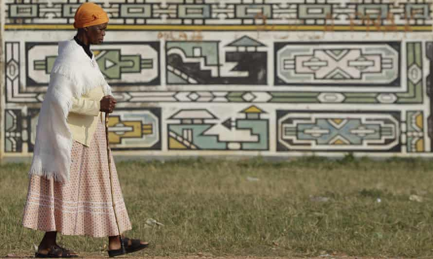 An woman walks home after casting her vote in Mpumalanga/