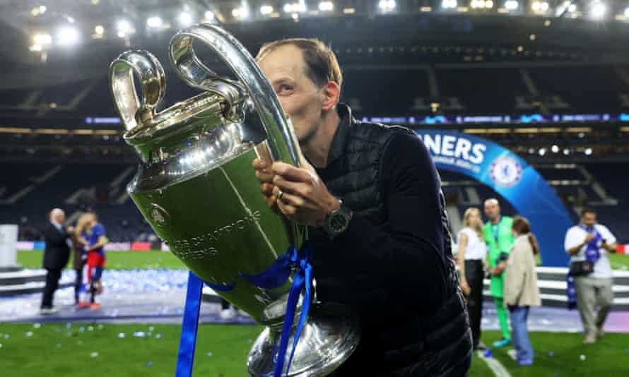 Thomas Tuchel kisses the Champions League trophy.