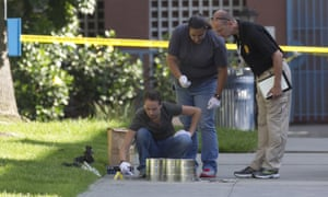 Police gather evidence at the scene of one of the attacks on homeless people in San Diego.