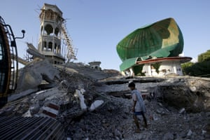 A resident inspects a mosque damaged by the earthquake in North Lombok, Indonesia.