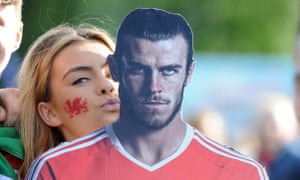 A Welsh supporter with a cardboard cutout of Gareth Bale