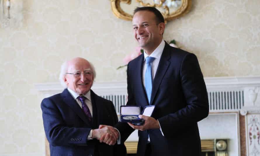Leo Varadkar receives his seal of office from Ireland's president Michael D Higgins.