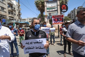 People in Idlib protest against Russian and Chinese vetoes on a UN security council resolution to enable aid to reach rebel-held areas of Syria.