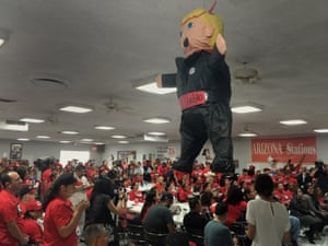 Members of the Culinary Workers Union Local 226, cheer during a rally under a Donald Trump piñata in Las Vegas.