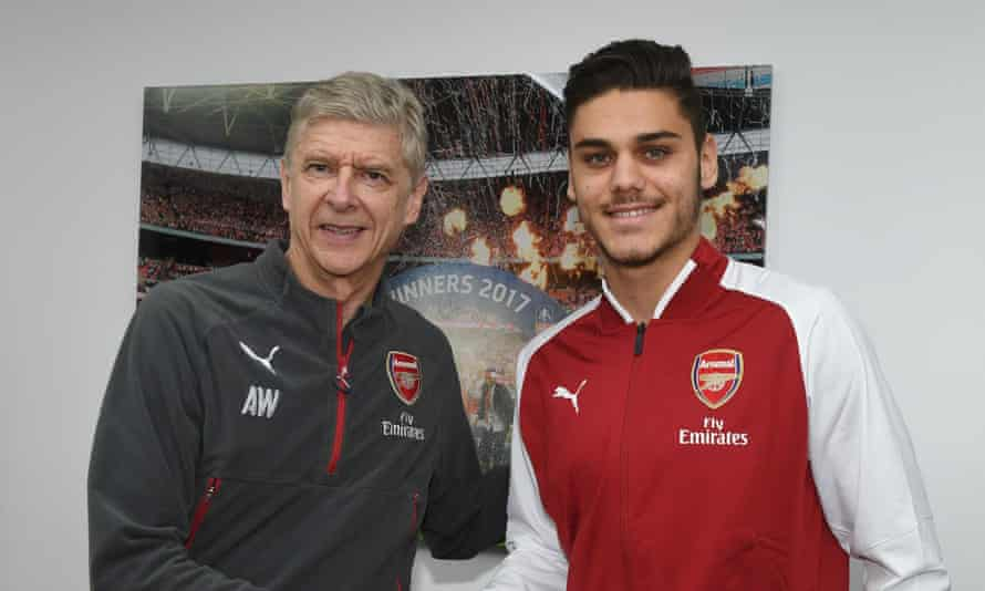 Konstantinos Mavropanos shakes hands with Arsène Wenger after agreeing a transfer to Arsenal.