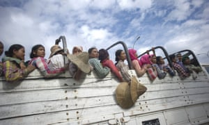 Workers ride on the back of a truck in Naypyidaw.