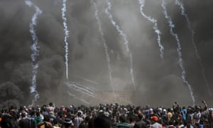 Israeli army fire tear gas grenades at Palestinian protesters during clashes after protests near the border with Israel in the east of Gaza Strip