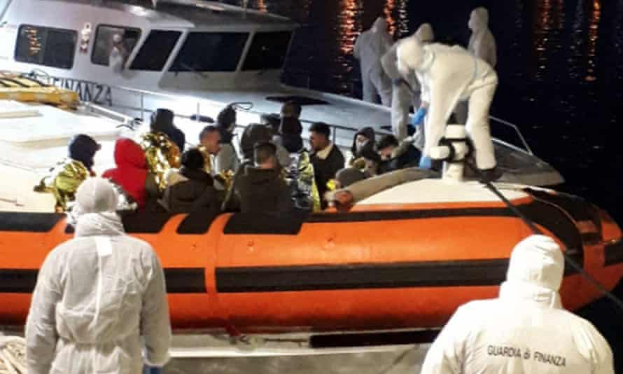 Migrants arriving at the port of Lampedusa, Sicily, last month