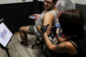 Sept 2018: Gabriel, now 20, gets a tattoo of a testosterone molecule and the words 'Self-made man' at a tattoo parlour in Madrid